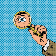 Eye and magnifying glass cartoon